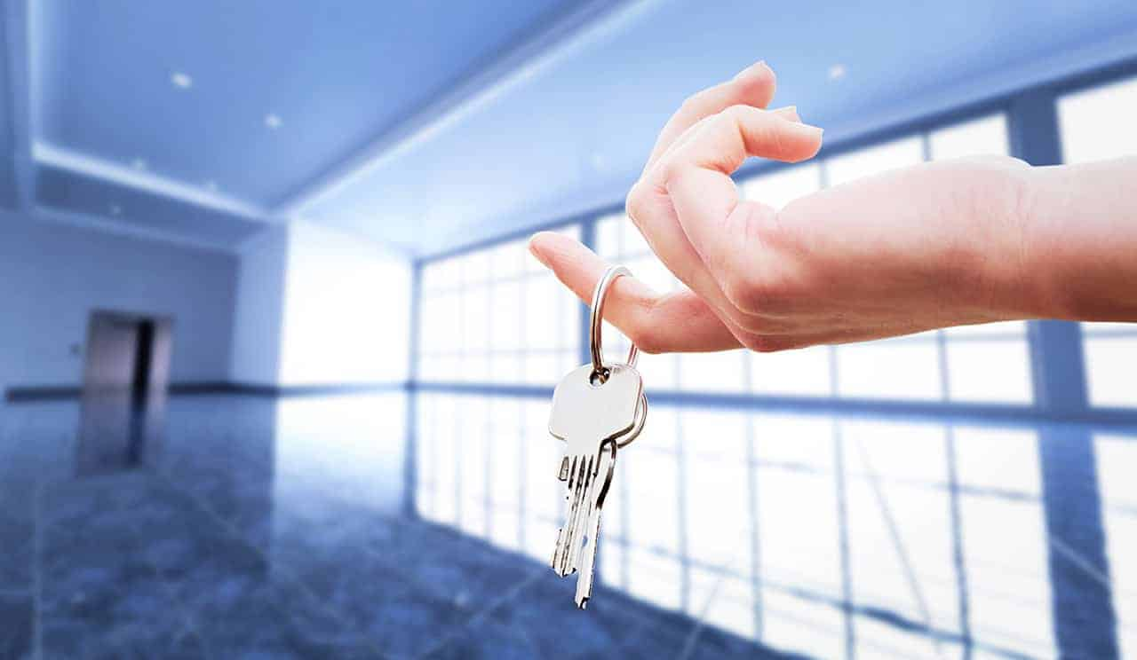 Woman's hand holding the keys to an apartment. Real estate agent. House ownership.